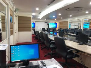 Video conference system using Minnray 4K PTZ camera displaying remote, local and presentation slides on Multiple TVs and monitors.